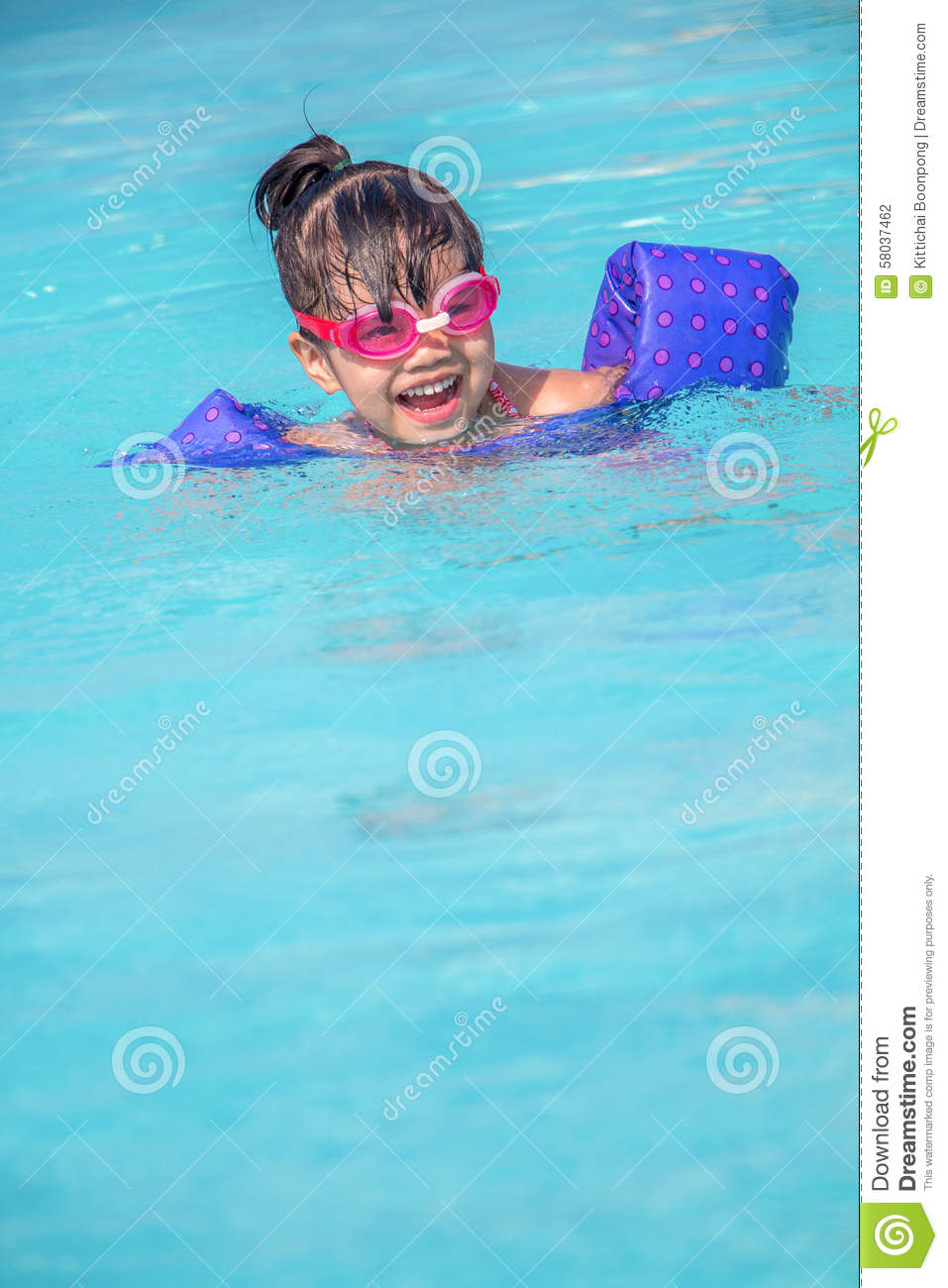 Child Playing In Swimming Pool Stock Photo