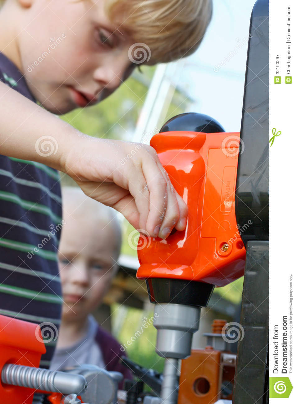 Child Playing With Toy Tools Royalty Free Stock