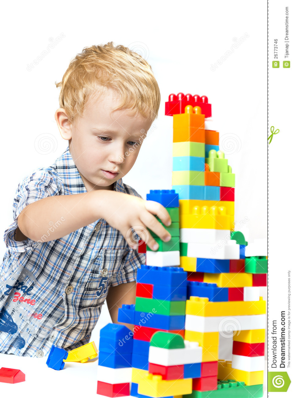 Play With Patterns Prints And Lots Of Accessories For: Child Playing With Toys Royalty Free Stock Image