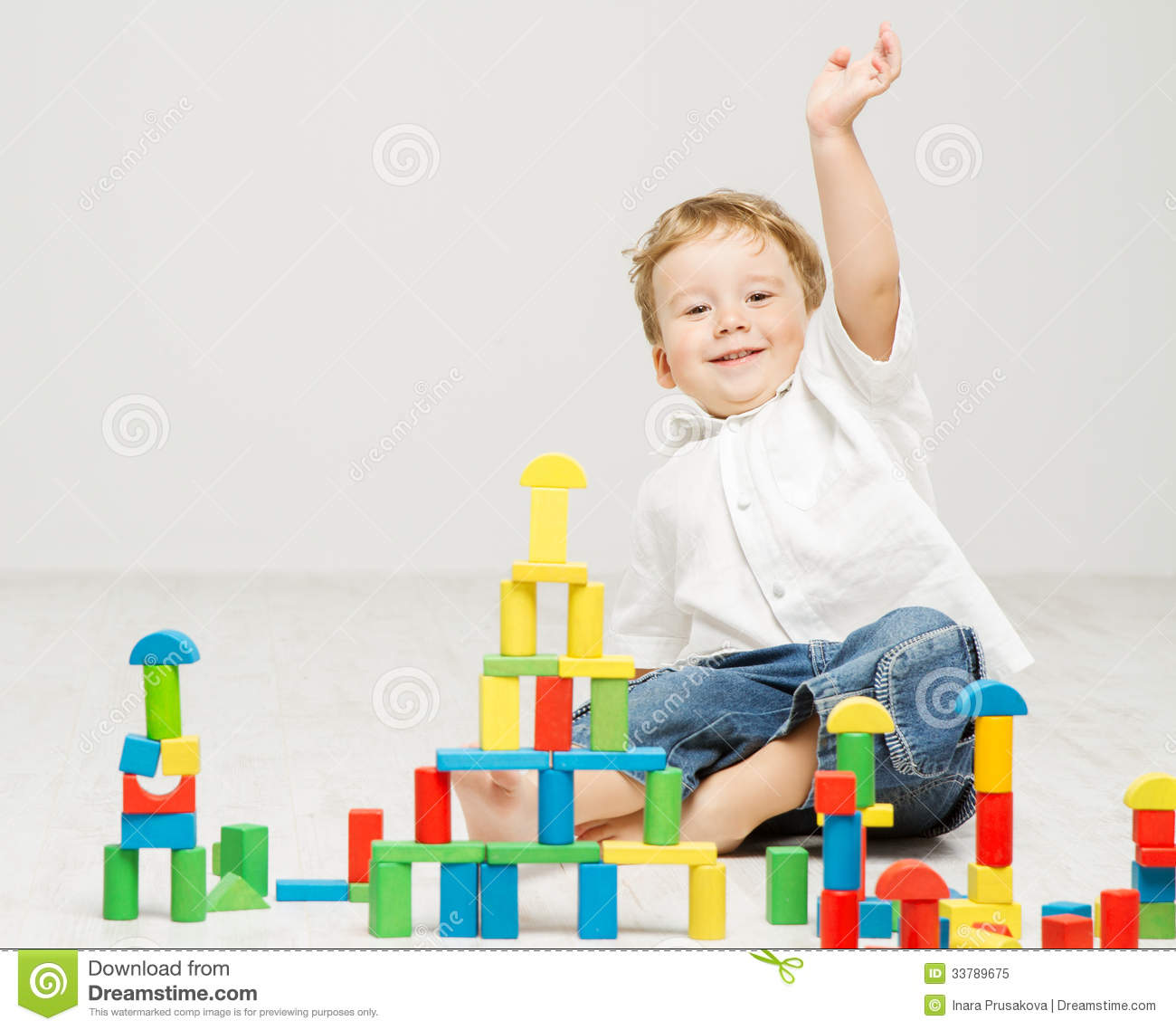 Child playing toys blocks over white royalty free stock for Happy playsets