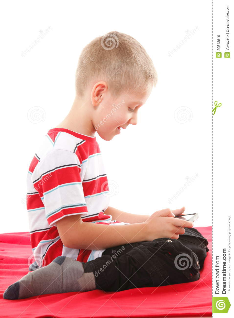Child Plays Games On The Mobile Phone Royalty Free Stock
