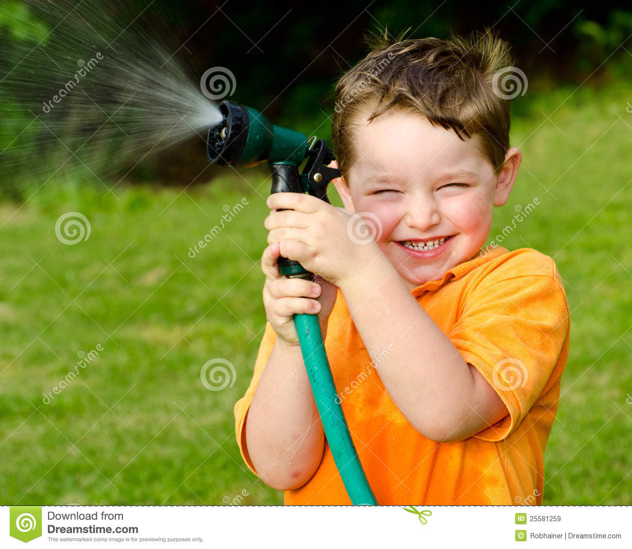 Child plays with water hose outdoors