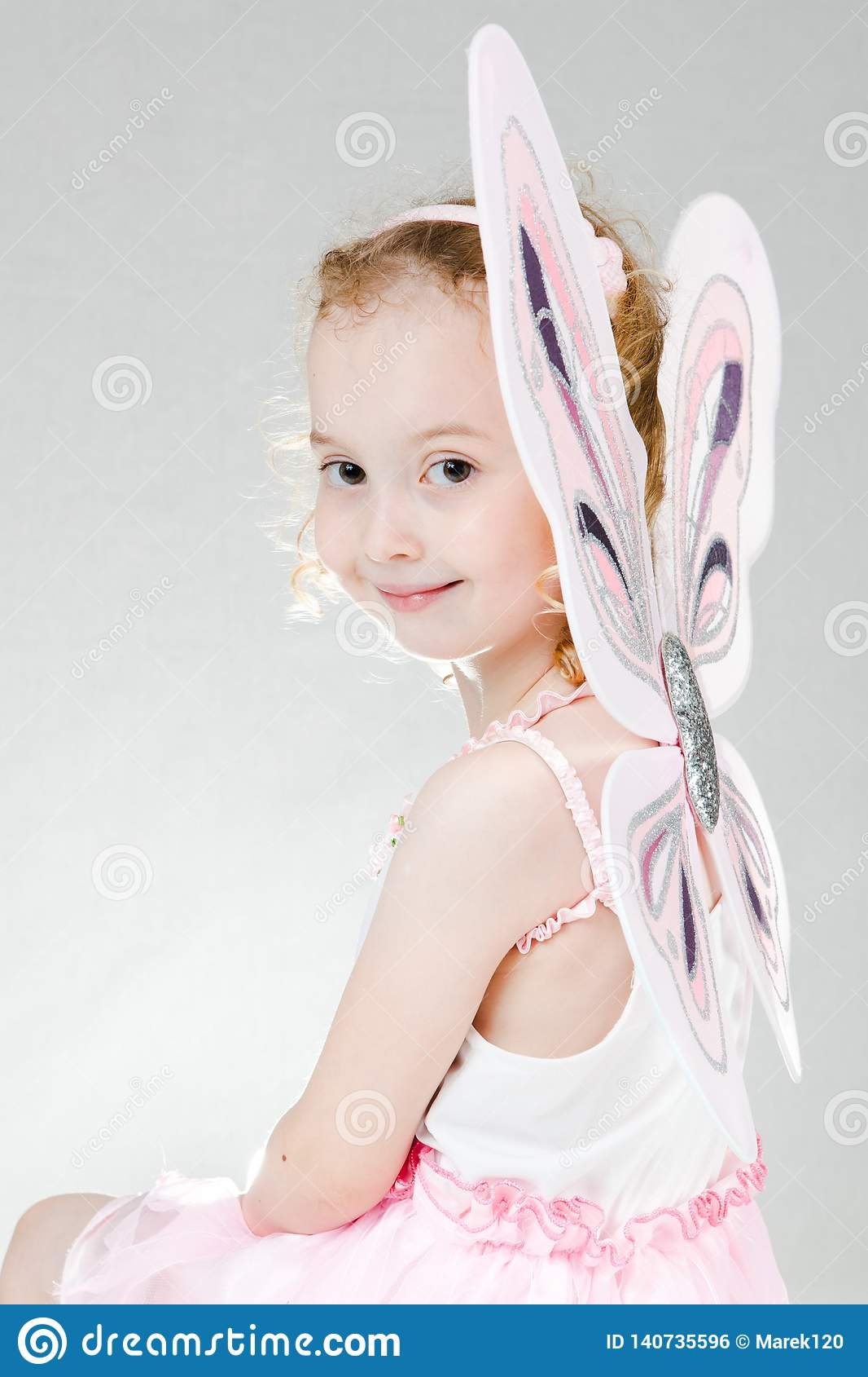 Child posing as fairy - butterfly wings