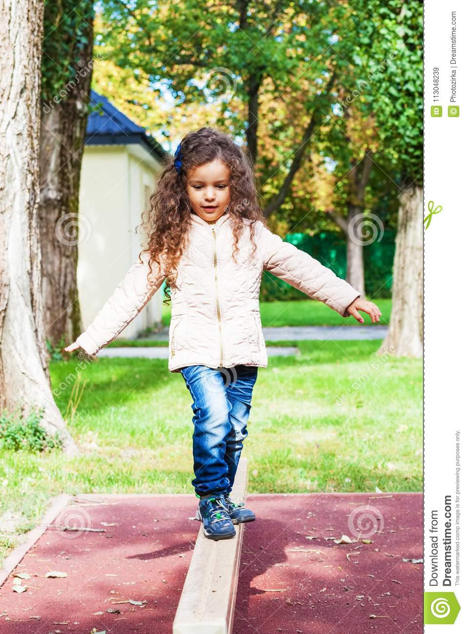 Child Is Practice Balancing In Playground Stock Image