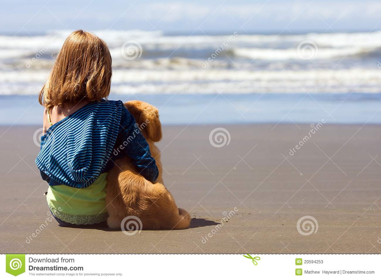 Child and Puppy at the beach