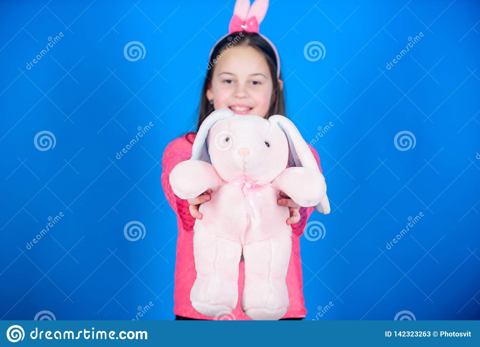 Child in rabbit bunny ears. Happy easter. Spring party. Egg hunt. Family holiday. Little girl with hare toy. Young and