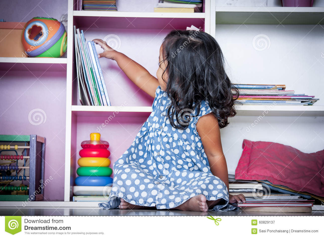 Download Child Read Cute Little Girl Selecting A Book On Bookshelf Stock Image