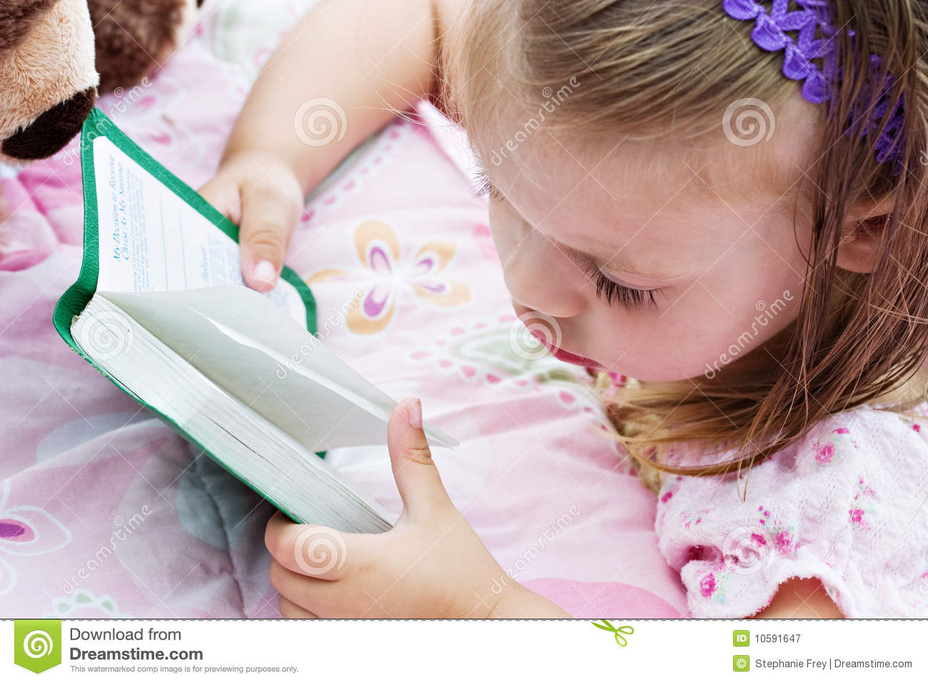 Child reading Bible stock image  Image of night, pink - 10591647