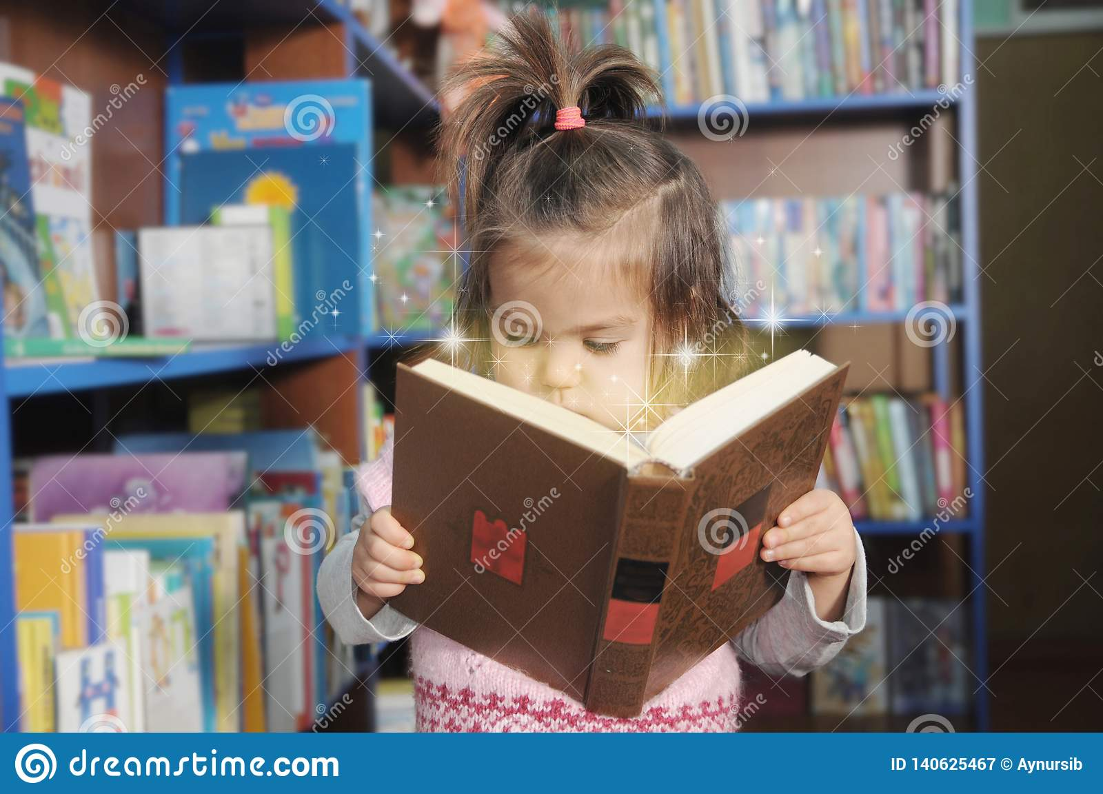 Child Reading Magic Book  Little Girl In Laibrary Looking