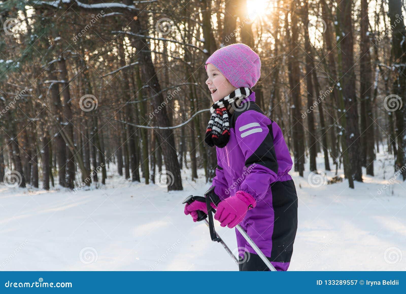 Child rides on skis. forest in winter winter ski child