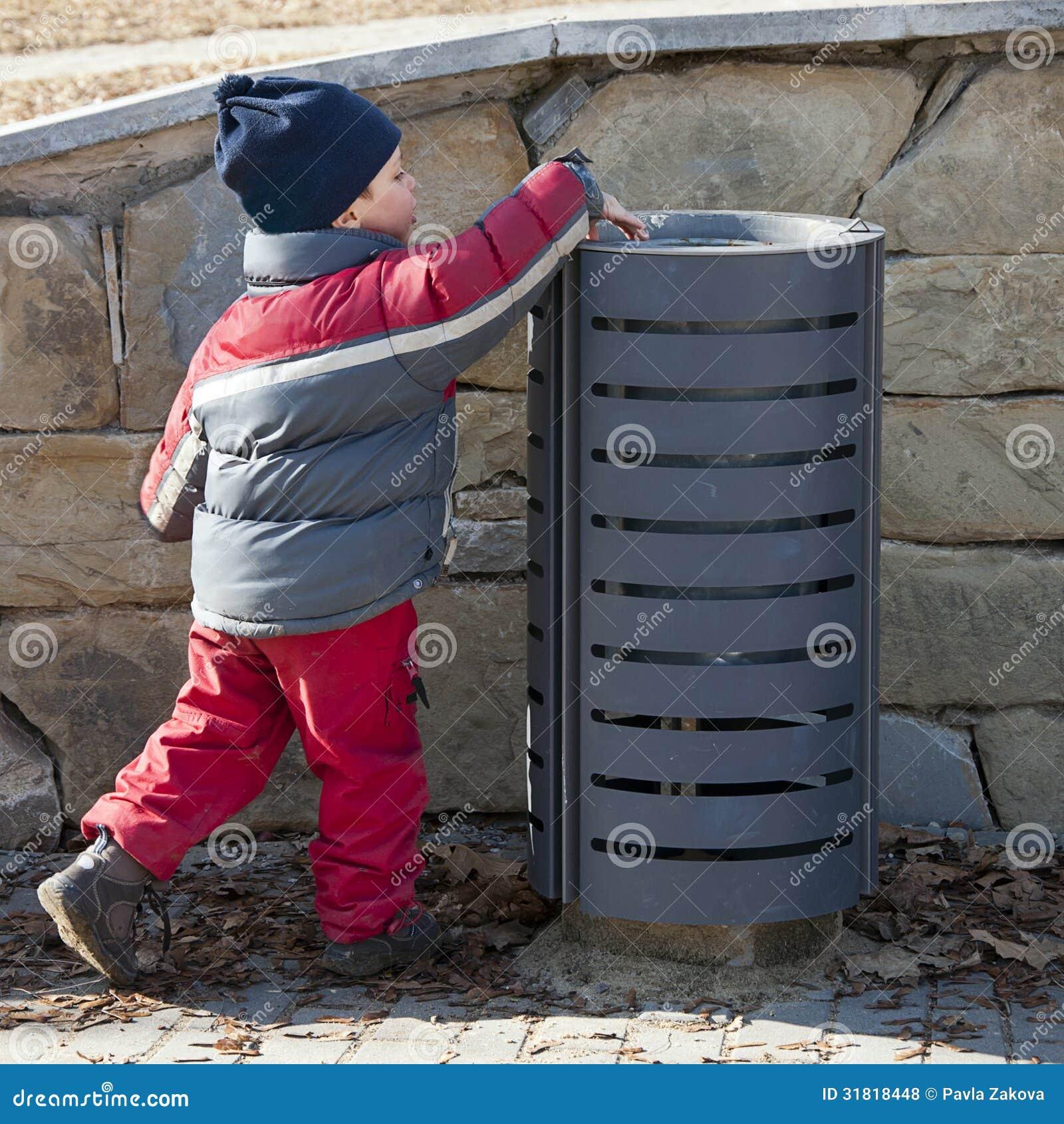 Child At Rubbish Bin Royalty Free Stock Photos Image