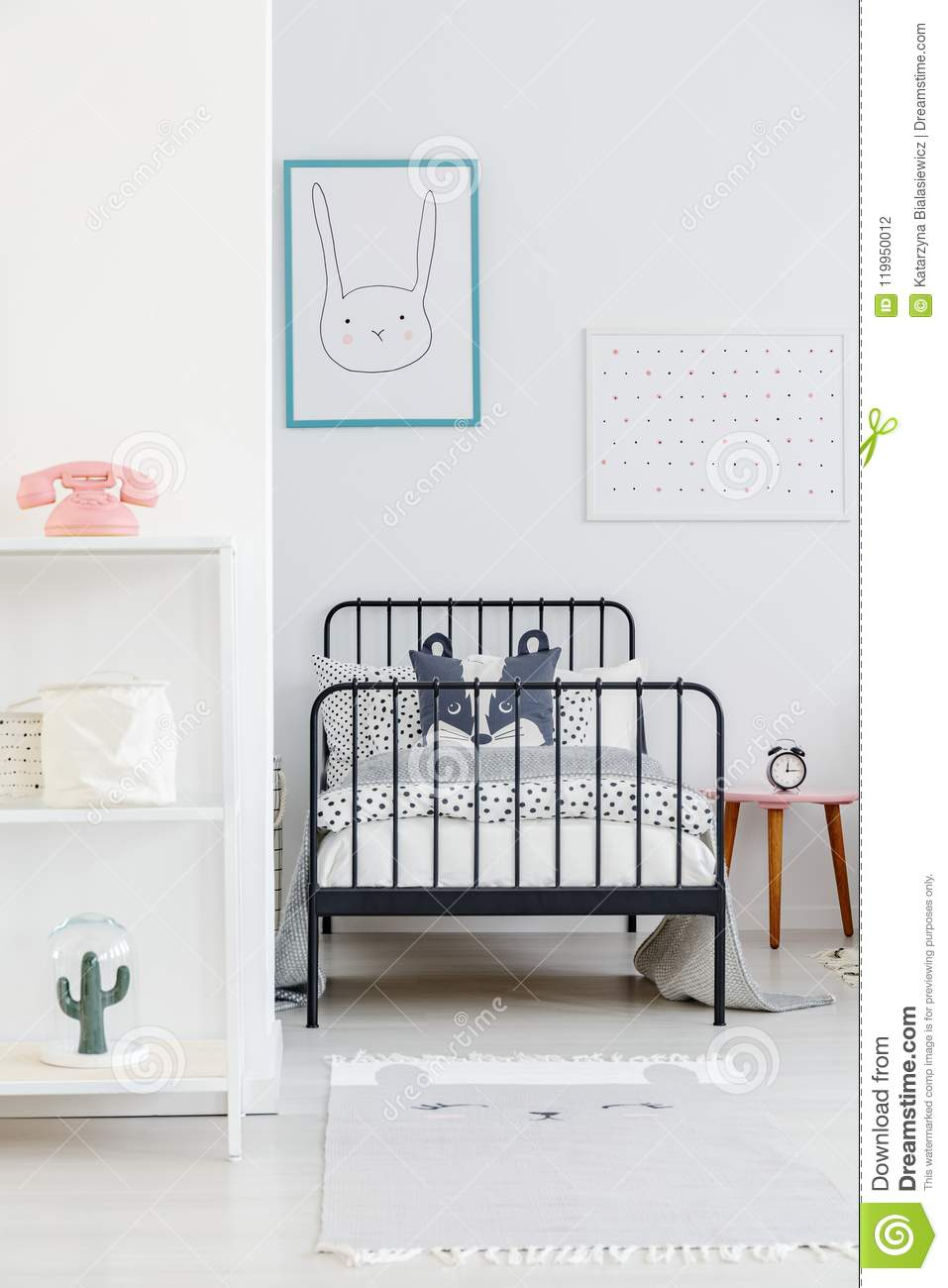 Child S Bed With Black Metal Frame In A Small Simple Bedroom In Stock Photo Image Of Child Frame 119950012