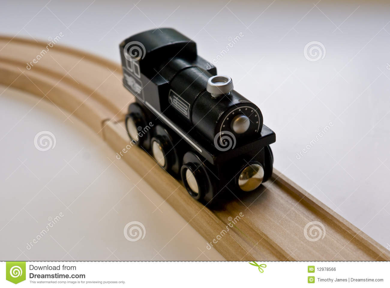 Child's Black Wooden Toy Train On Wood Tracks Royalty Free Stock Image ...