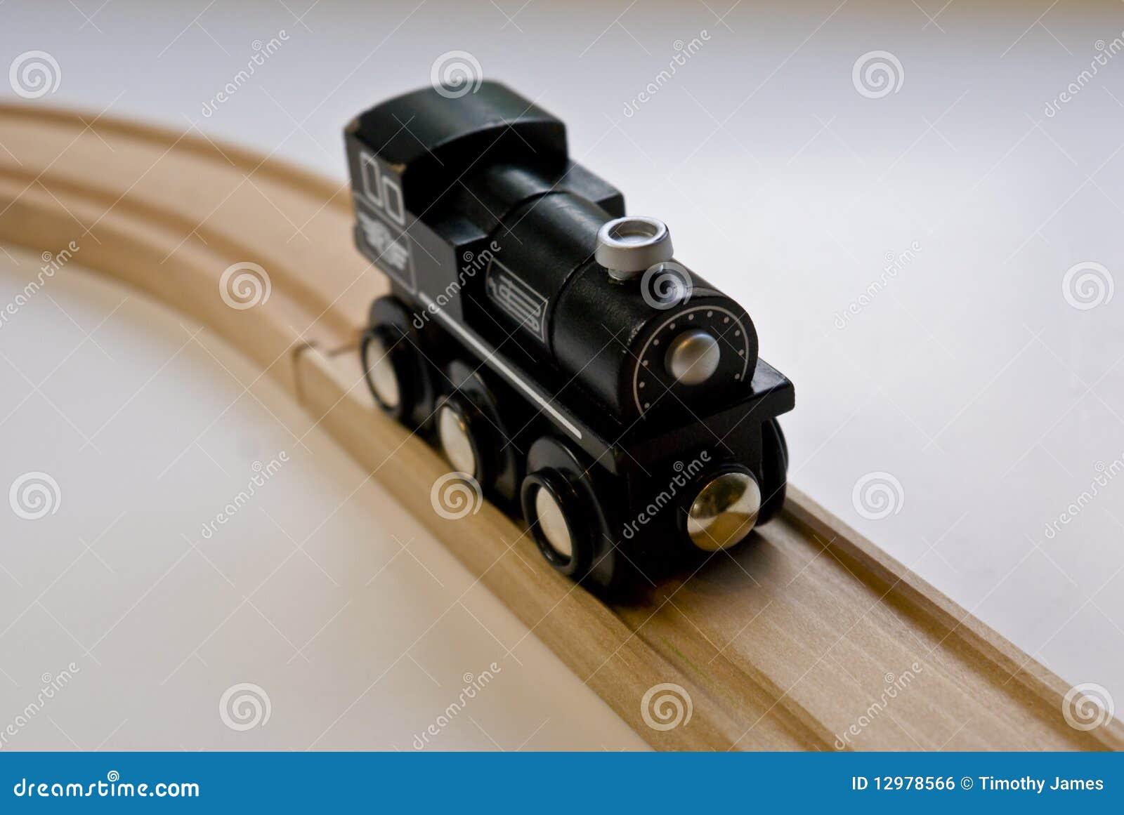 Child's Black Wooden Toy Train On Wood Tracks Royalty Free Stock Image - Image: 12978566