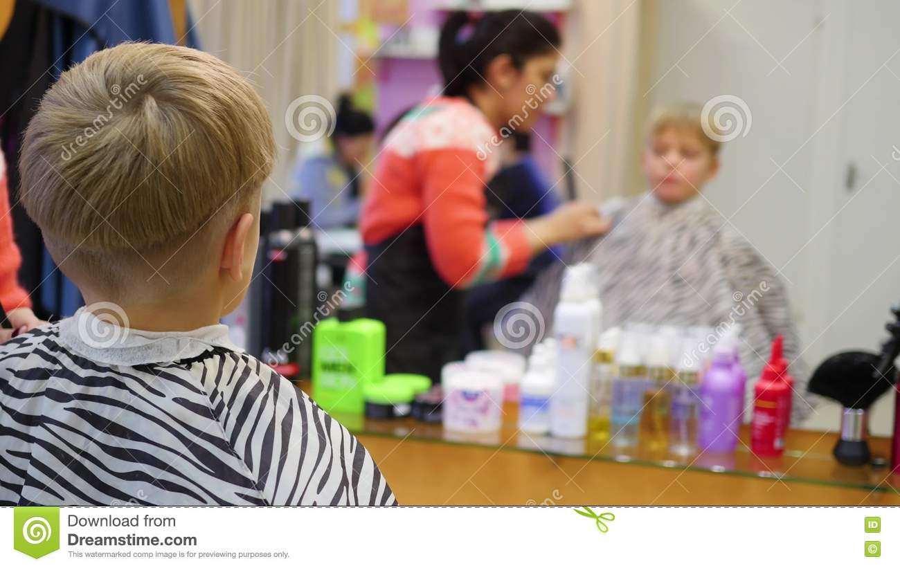 Childs haircut at the barber shoplooking at yourself in the mirror childs haircut at the barber shoplooking at yourself in the mirror stock video video of clippers hairdresser 81631007 solutioingenieria Images