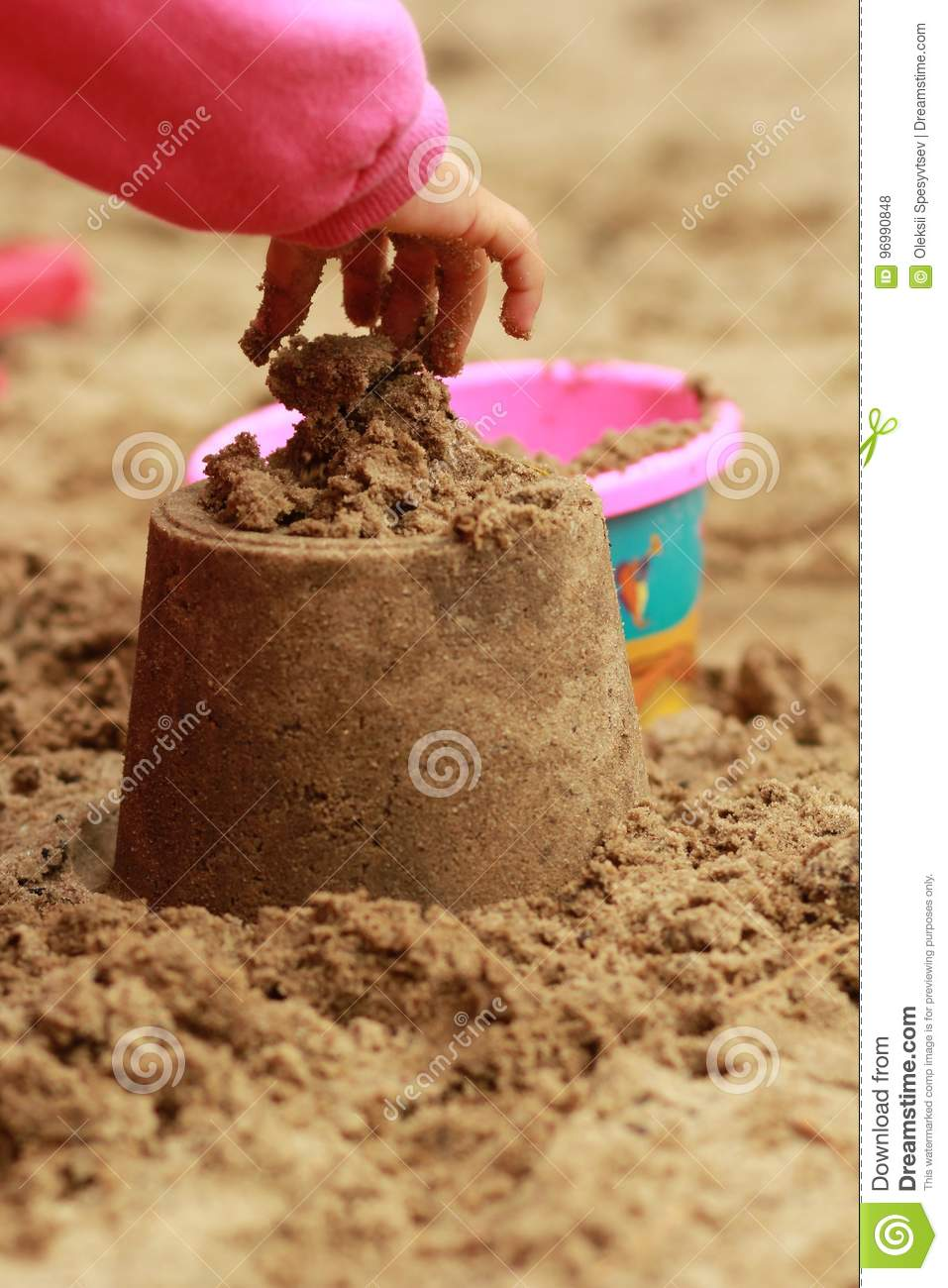 A Child S Hand Making A Sand Castle In The Sandbox Sand Therapy Through Playing Stock Photo Image Of Close Preschool 96990848