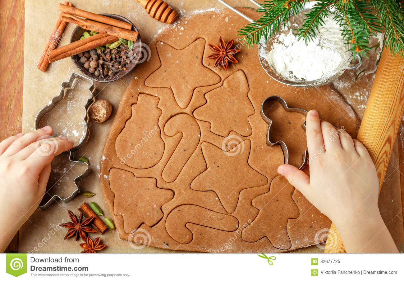 Child S Hand Making Traditional Christmas Cookies Stock Image