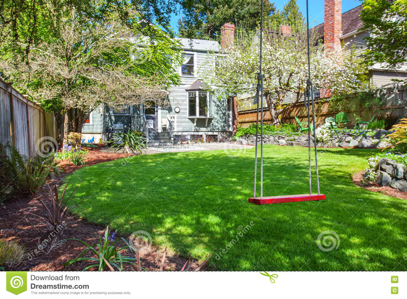 Child's Swing Sit In The Backyard Garden With Well Kept ...