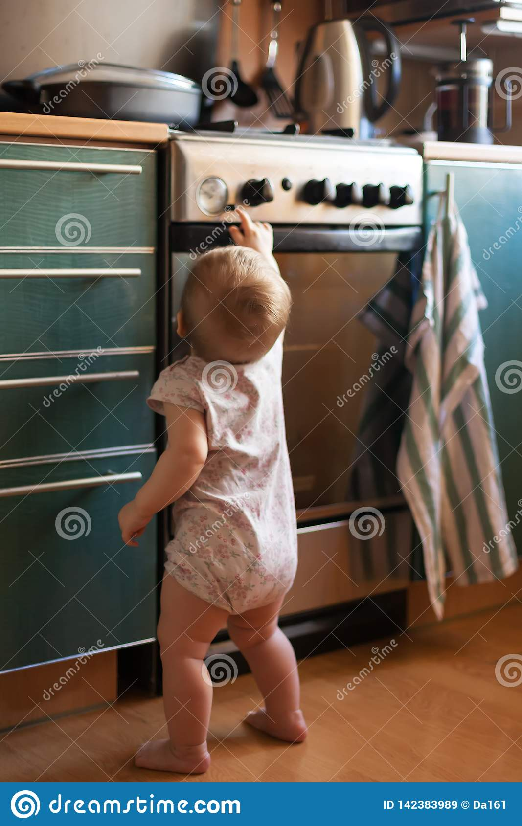Child Safety In Kitchen Near Stove Stock Image - Image of