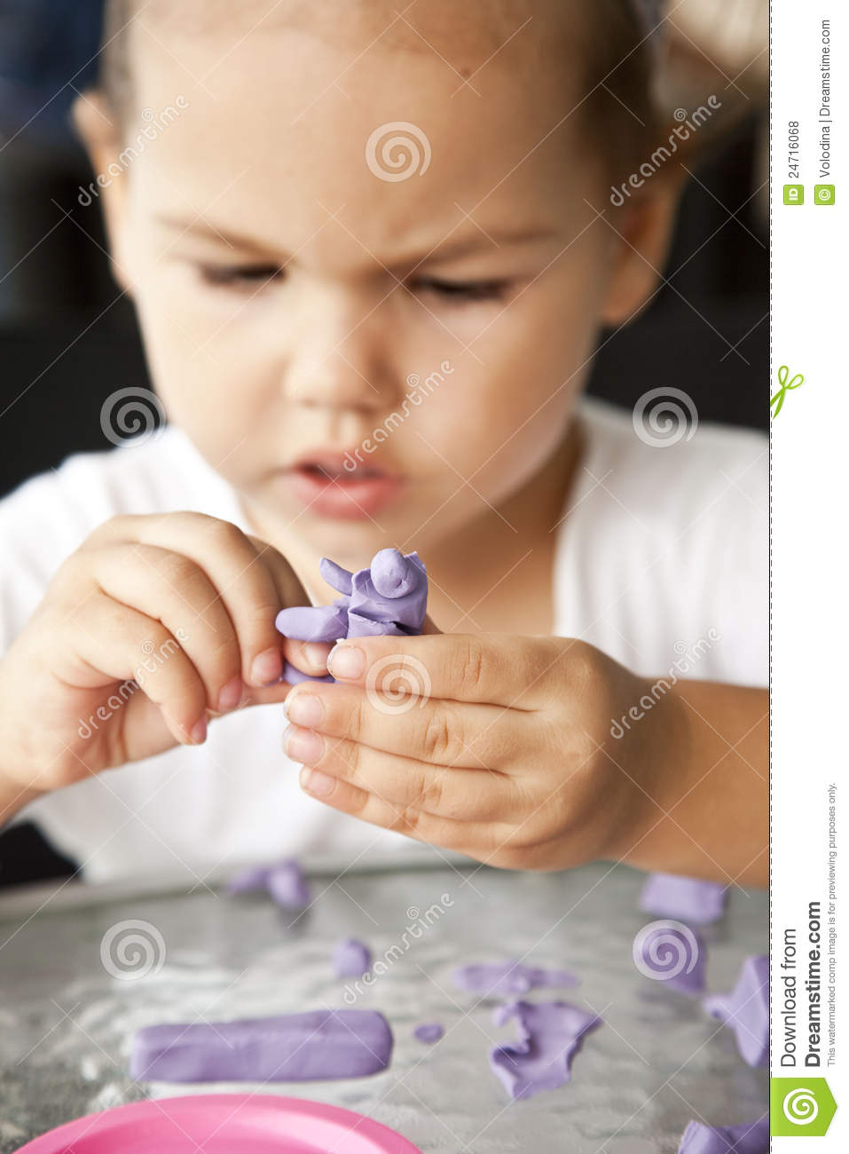 Child sculpts from clay