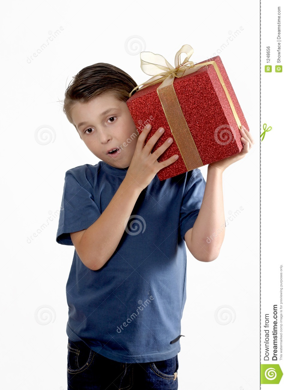 Child Shaking A Wrapped Present Royalty Free Stock Image ...