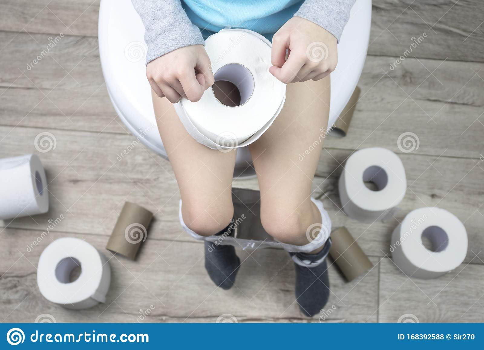 Young Boy Sitting On Toilet High-Res Stock Photo - Getty