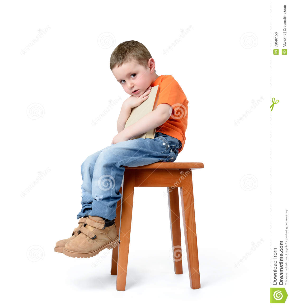 Child Sitting On A Chair With A Book On White Background