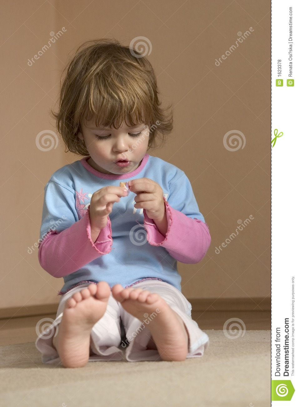 Child Sitting On The Floor Royalty Free Stock Photos