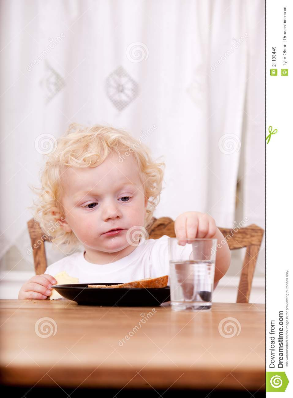 Child Sitting at Table