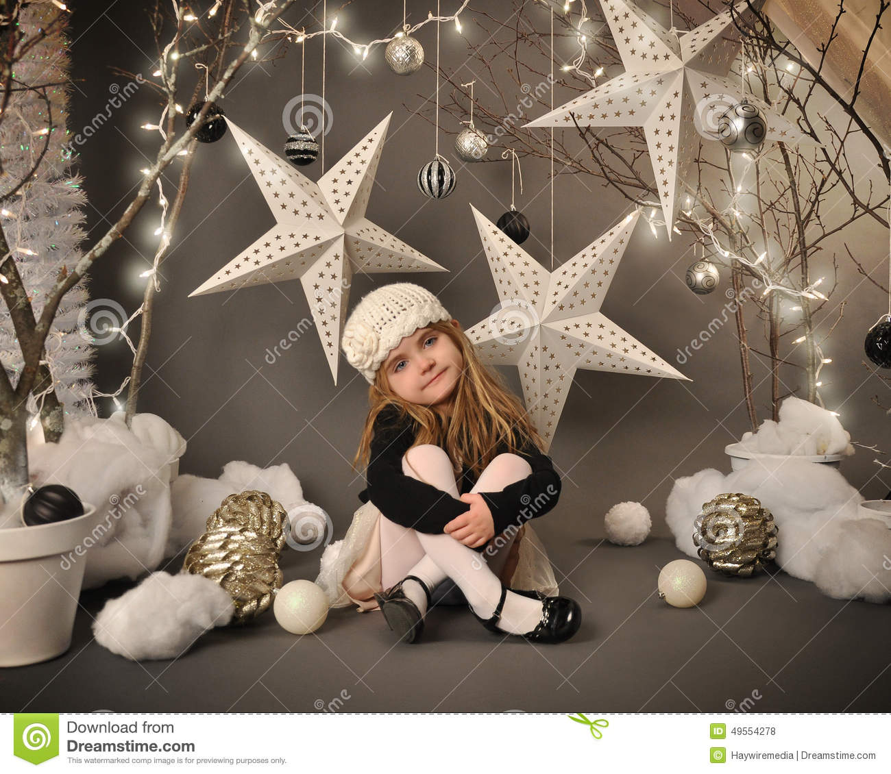 Little Girl Christmas Tree: Child Sitting In Winter Tree Star Scene Stock Photo
