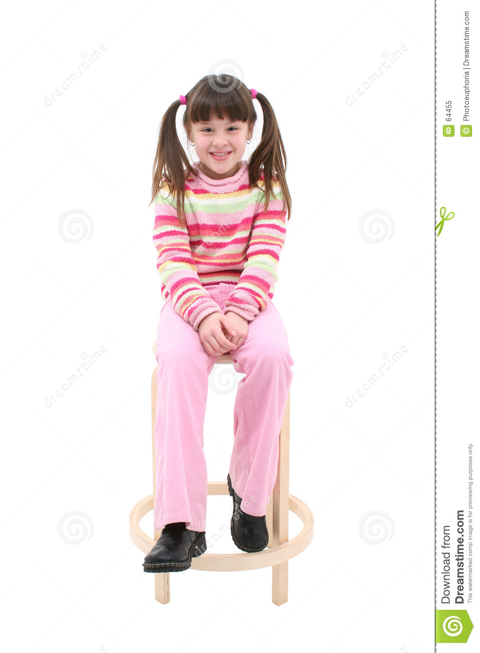 Child Sitting On a Wooden Stool