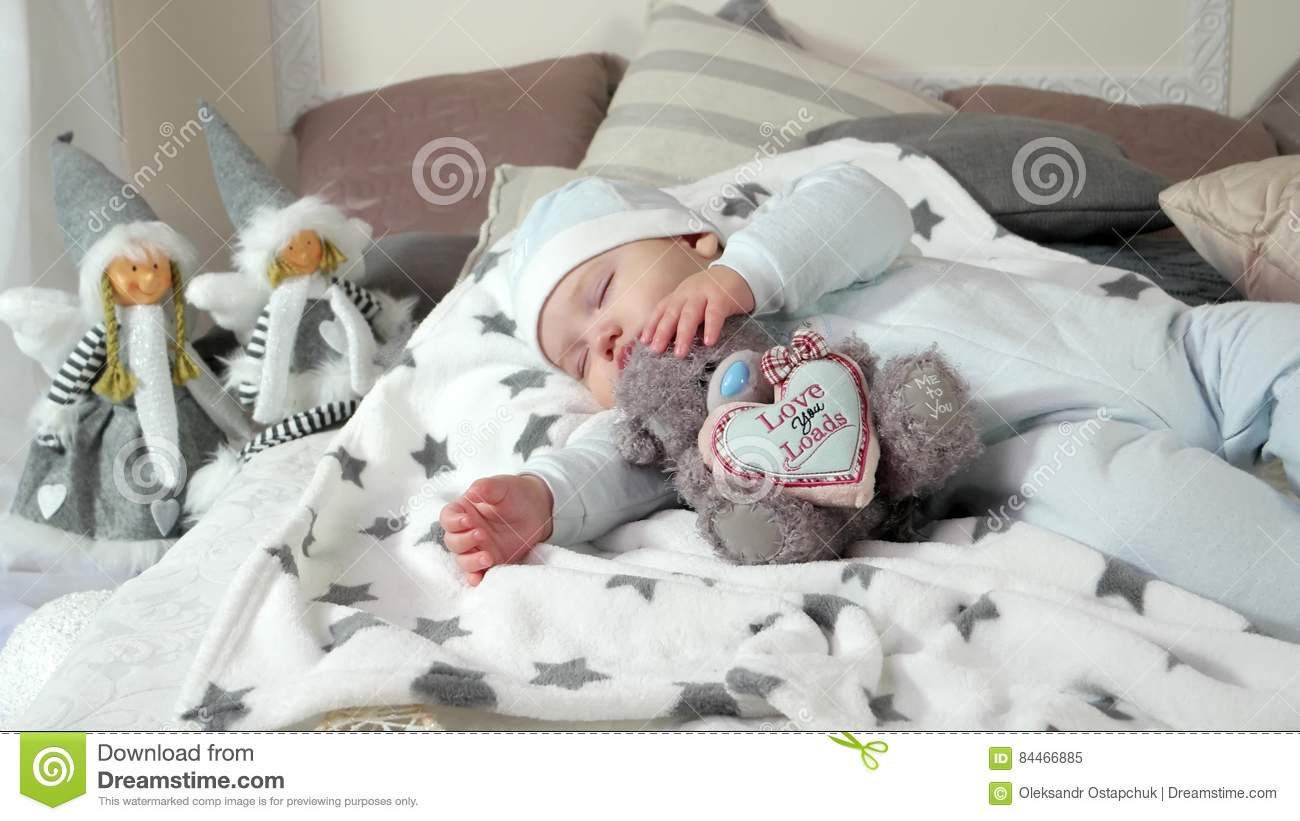 Baby bed for parents bed - Child Sleeping On Parents Bed In A Cozy Atmosphere In The House Little Boy Asleep Hugging A Stuffed Toy Sweet Baby Stock Video Video 84466885