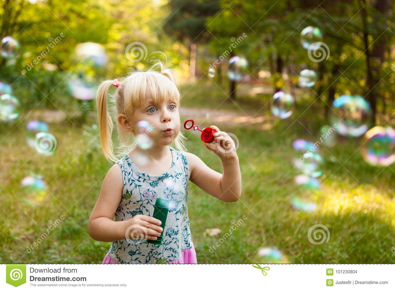 Child and soap bubbles in summer