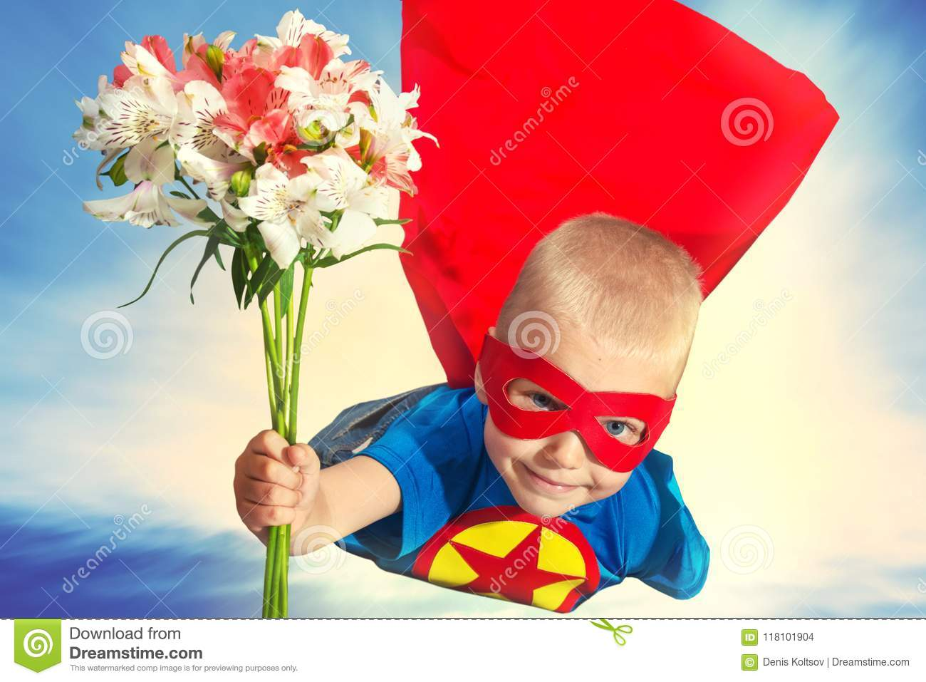 A Child In A Superhero Costume With A Bouquet Of Flowers Flies To