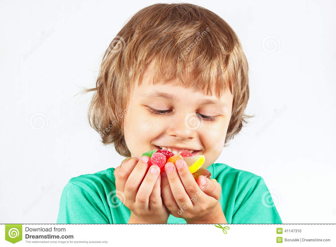 Child with sweets and colored jelly candies on white background