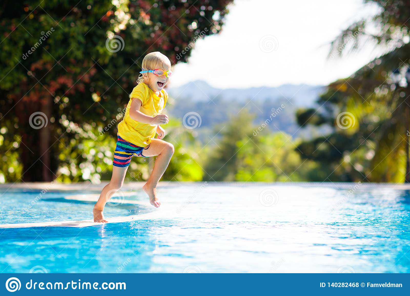 Child in swimming pool. Summer vacation with kids