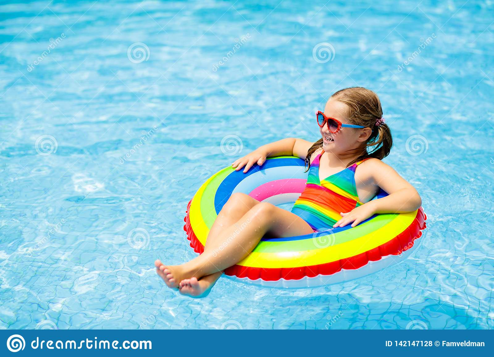 Child In Swimming Pool On Toy Ring. Kids Swim Stock Photo ...