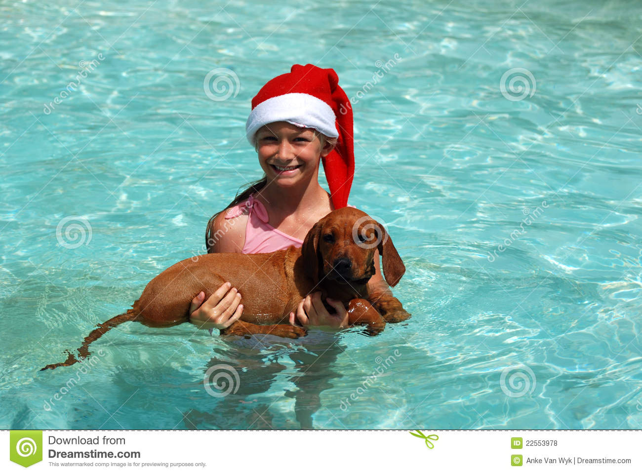 Child swimming with puppy