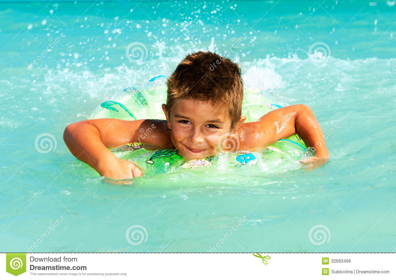 Happy Child Playing and Swimming in the Sea. Summer Vacations Concept.