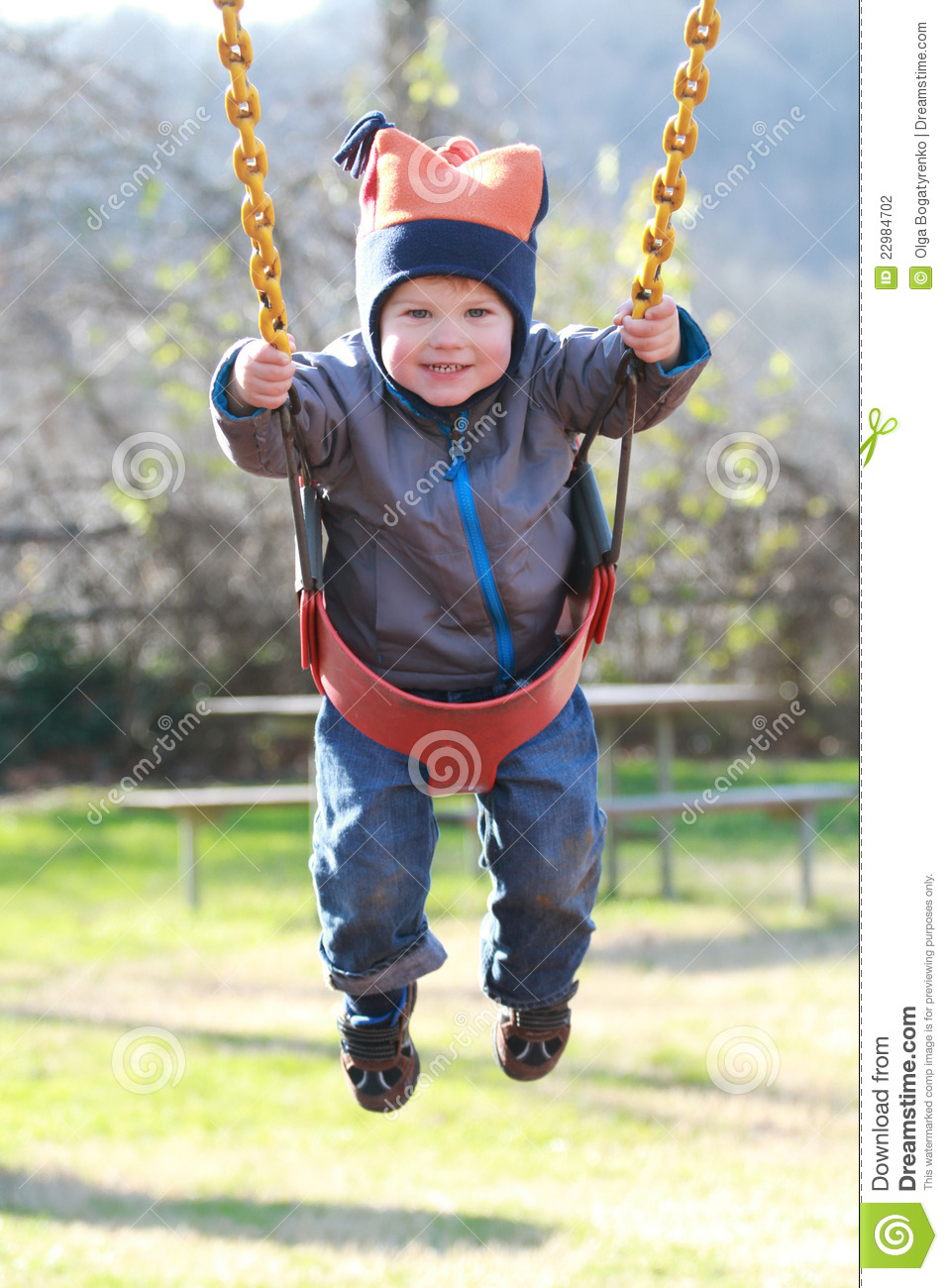 Child On Swing At A Playground Stock Photo - Image of ...