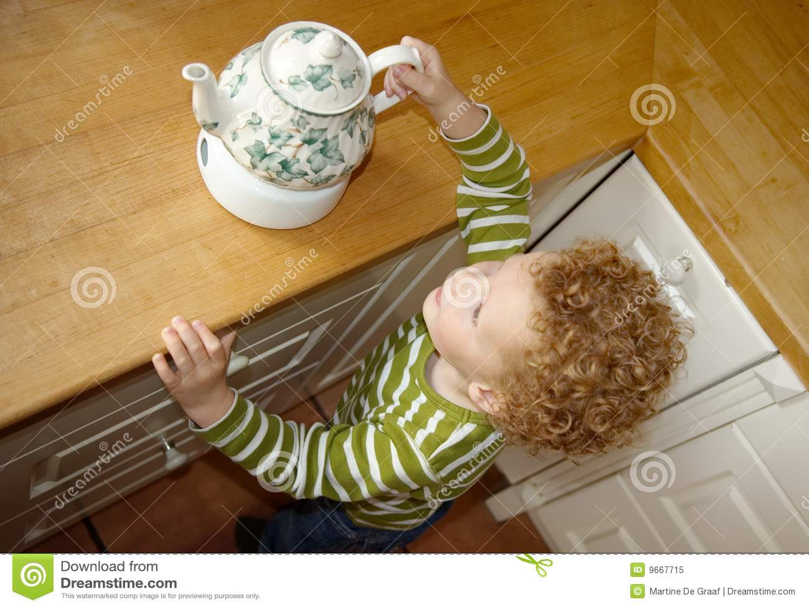 Child taking Teapot