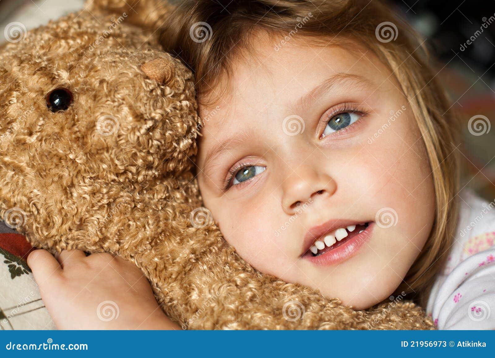 child with teddy bear stock photos