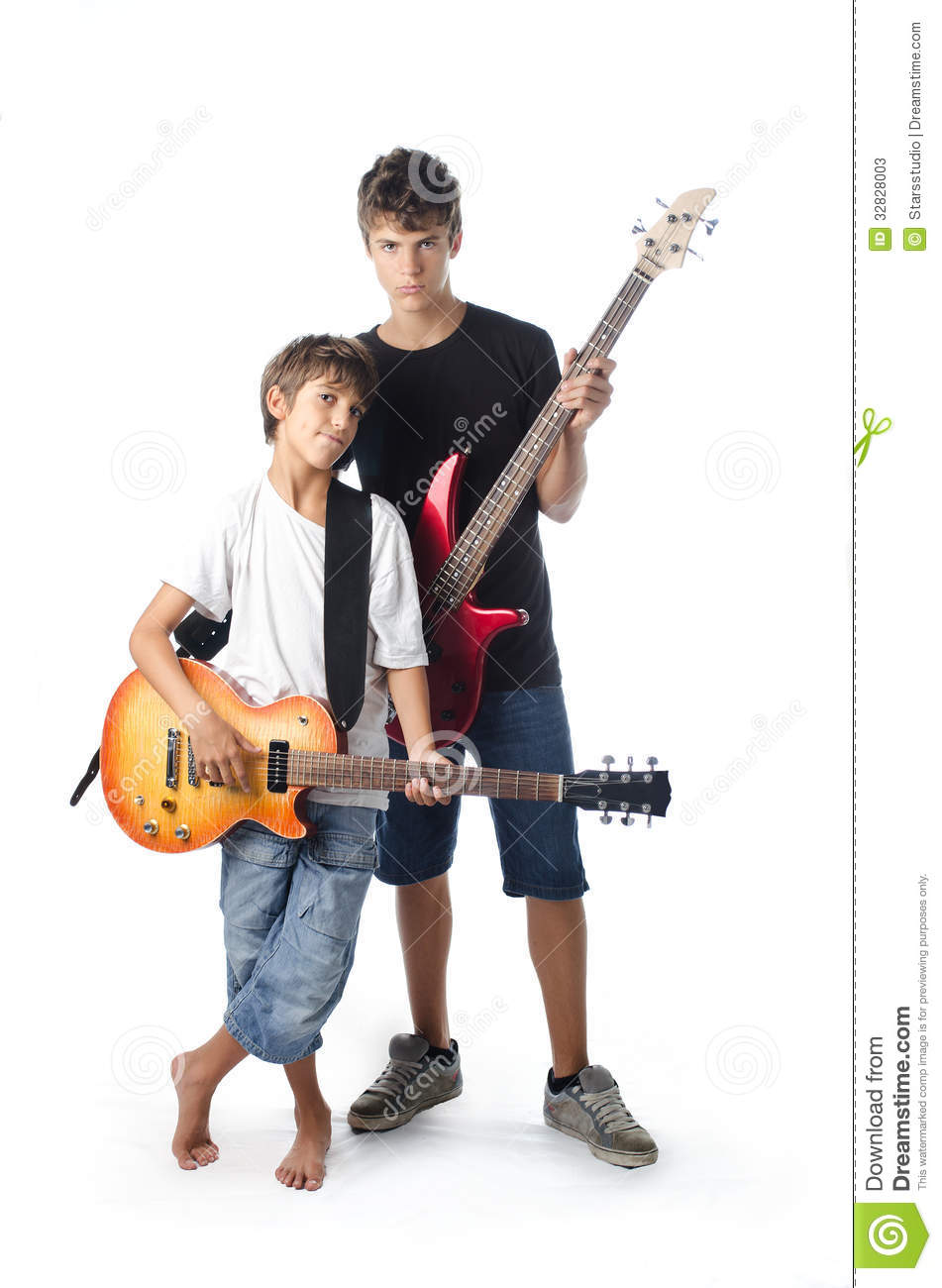Child and teenager with guitar and bass