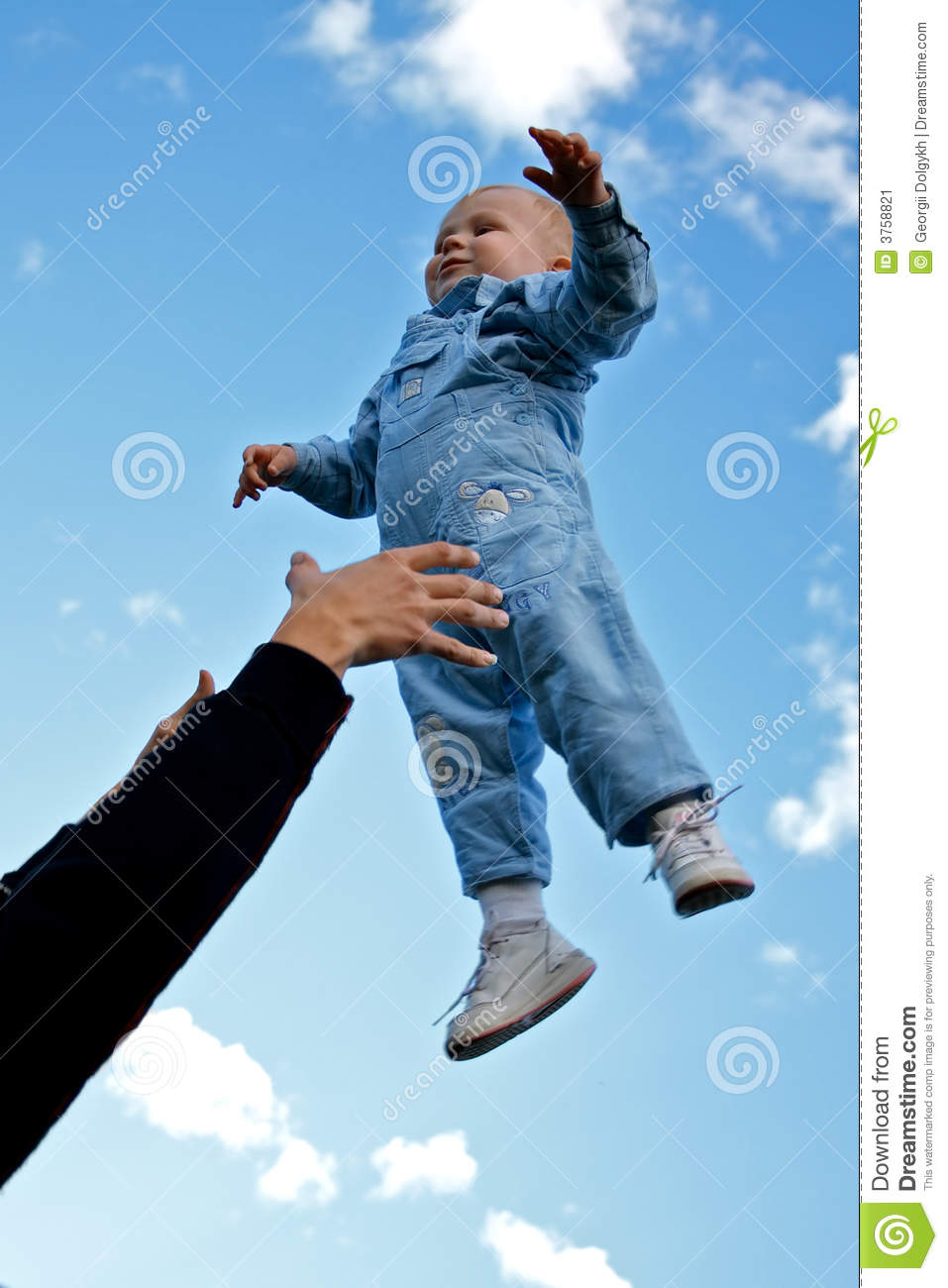 Child Thrown Up In The Air Stock Image - Image: 3758821