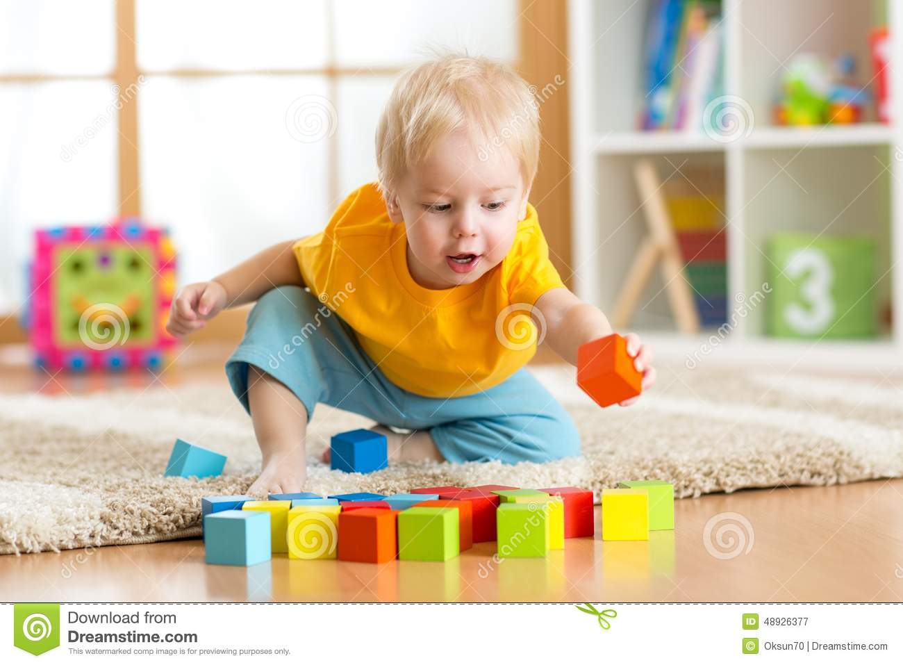 Home Play Toys : Child toddler playing wooden toys at home stock photo