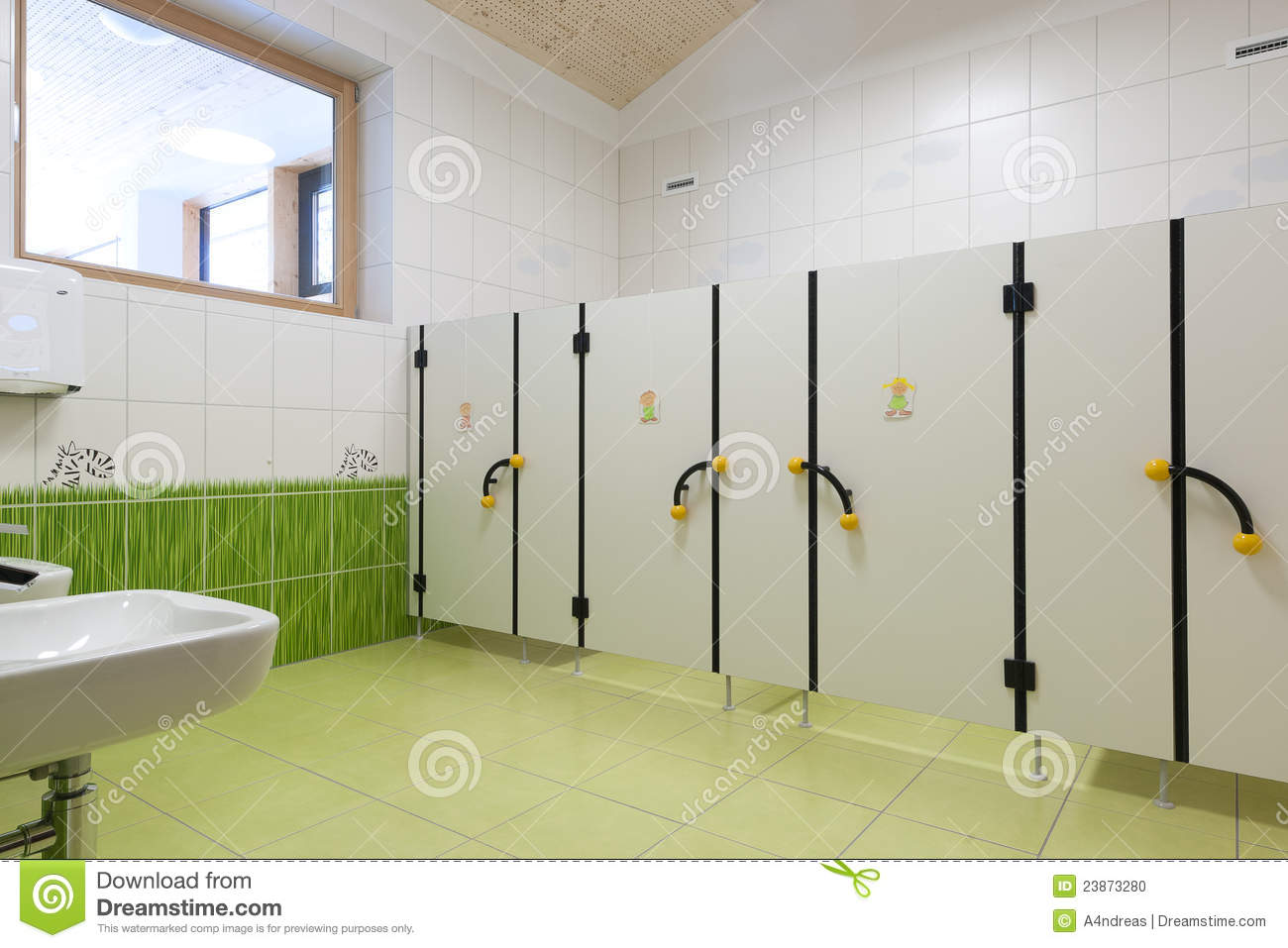 child toilets in kindergarten with nice green gras stock photo image 23873280. Black Bedroom Furniture Sets. Home Design Ideas