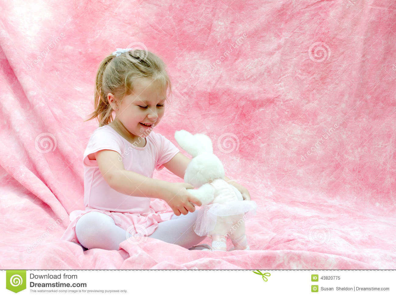 Child with toy ballerina bunny