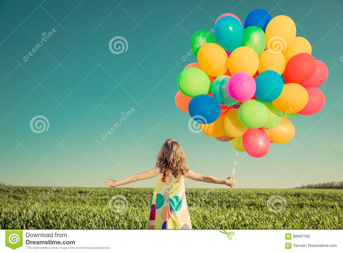 Download Child With Toy Balloons In Spring Field Stock Photo - Image of grass, happiness: 88997762
