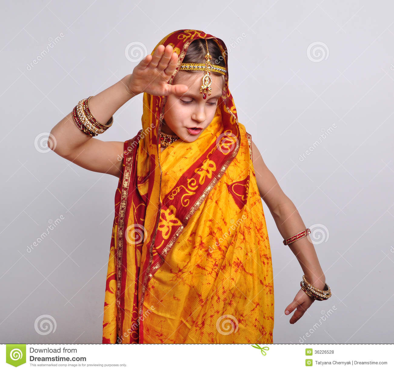 5614e3197a Child In Traditional Indian Clothing And Jeweleries Dancing Stock ...