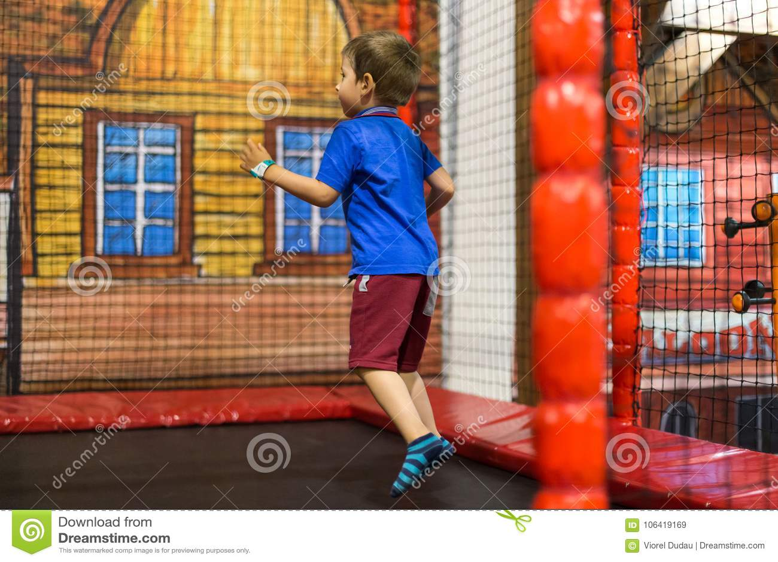 Child on trampoline at playground